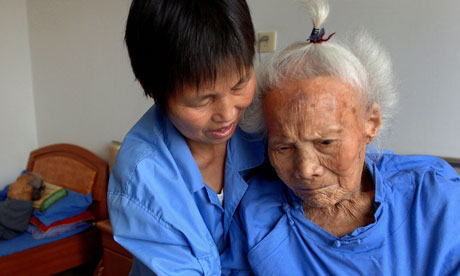 Nurse takes care of elderly woman